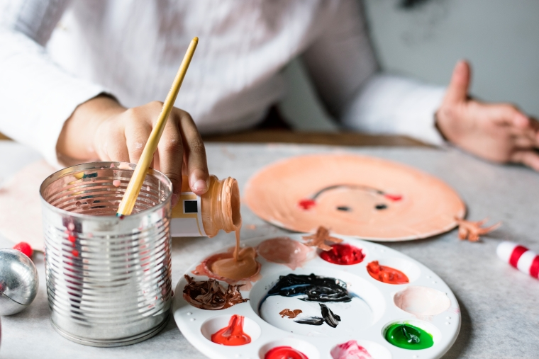 Kid painting Santa on a paper plate